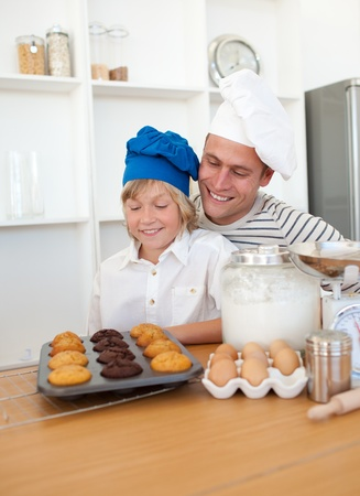 Charming father and his son presenting their muffins Stock Photo - 10256833