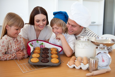 Merry family presenting their muffins photo