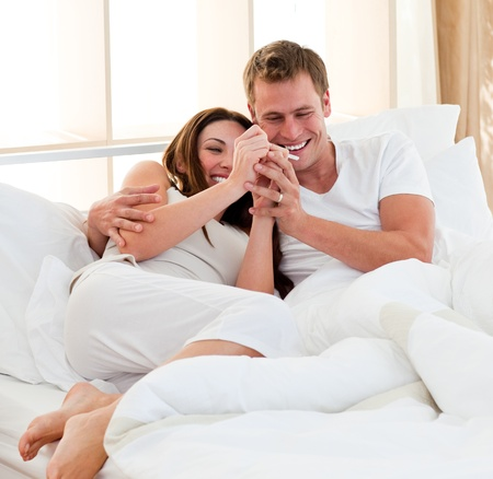 Lively couple finding out results of a pregnancy test photo