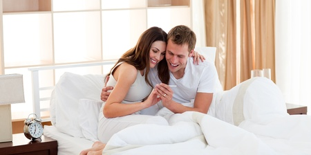 Merry couple finding out results of a pregnancy test Stock Photo