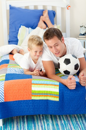 chirpy: Handsome father and his son playing with a soccer ball