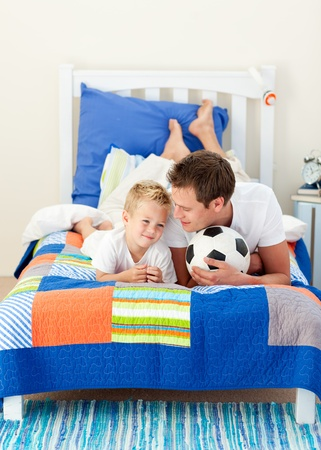 chirpy: Attractive father and his son playing with a soccer ball