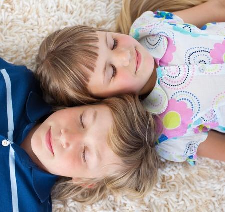 Siblings sleeping on the floor  photo