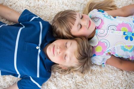 Cute siblings lying on the floor photo