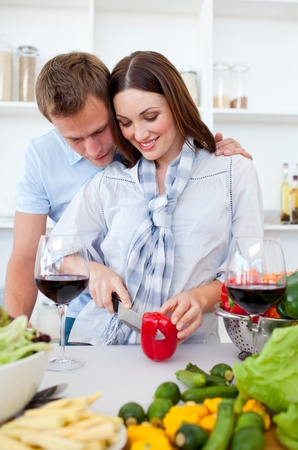 Intimate couple preparing dinner photo