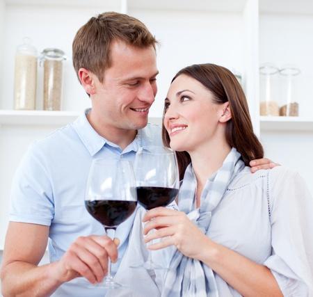 Loving couple drinking red wine photo