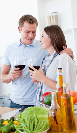 Romantic couple drinking wine while cooking  Stock Photo - 10231938