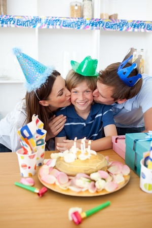 Affectionate parents celebrating their son's birthday Stock Photo - 10240605