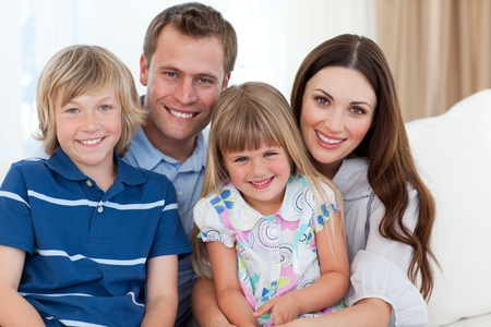Portrait of a happy family on the sofa Stock Photo - 10238645
