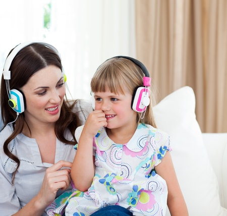 Portrait of a mother and her daughter listening music  photo