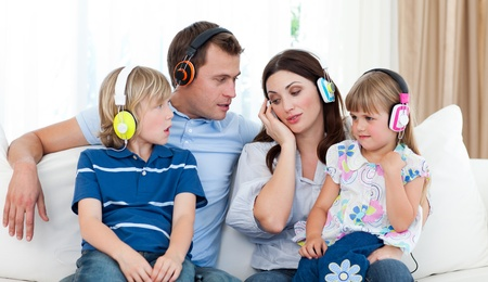 Family listening music with headphones  photo