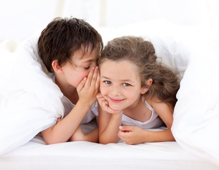 Little boy telling a secret to his sister Stock Photo - 10244094