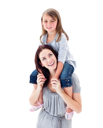Charismatic mother giving her daughter piggyback ride photo