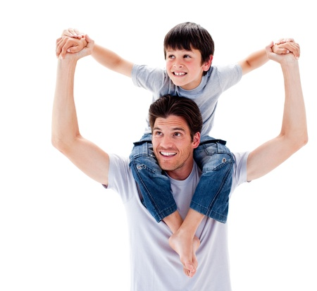 piggyback ride: Close-up of father giving his son piggyback ride