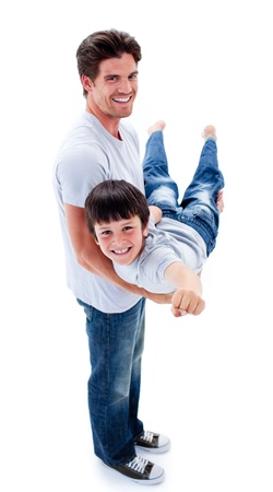 Adorable little boy carried by his father photo