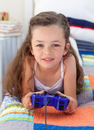 Little girl playing video games  photo
