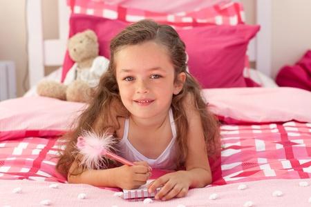 Cute girl lying on bed photo