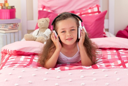 Little girl listening music photo