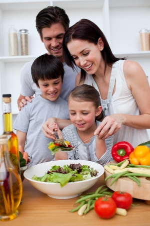 Happy family cooking together photo
