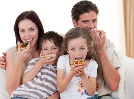 fast eat: Happy family eating pizza Stock Photo