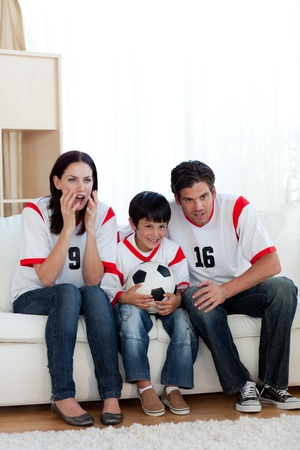 Concentrated family watching football match photo