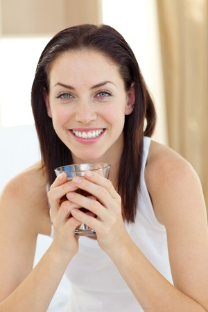 Smiling woman drinking tea  Stock Photo - 10258240