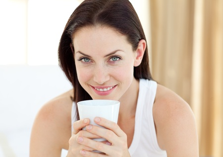 Close-up of a woman drinking a coffee  photo