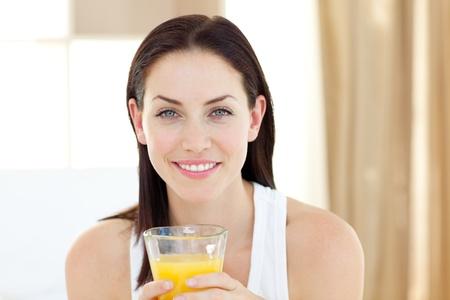 Beautiful woman drinking orange juice  photo