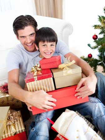 Happy father and son holding Christmas presents photo