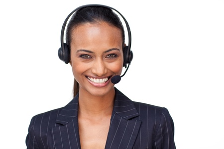 Beautiful ethnic businesswoman with a headset on smiling at the camera photo