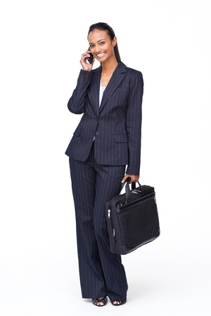 Beautiful businesswoman on phone going to work photo