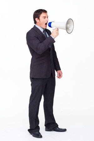 Standing businessman shouting through a megaphone photo