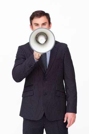 Young businessman shouting through a megaphone Stock Photo - 10258665
