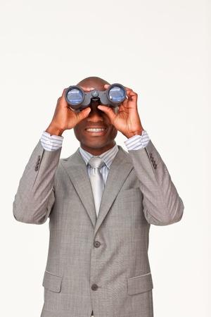 Afro-American businessman looking through binoculars photo