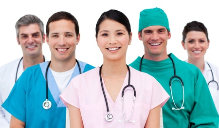 Pretty doctor with her team behind him photo
