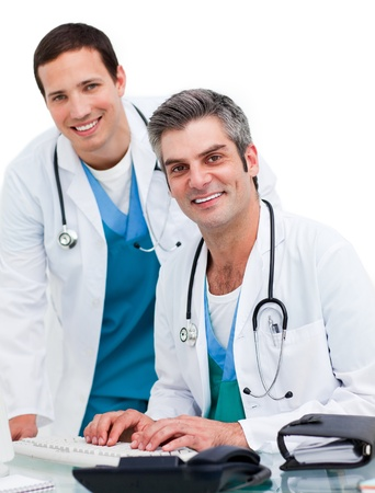 Happy doctors working at computer photo