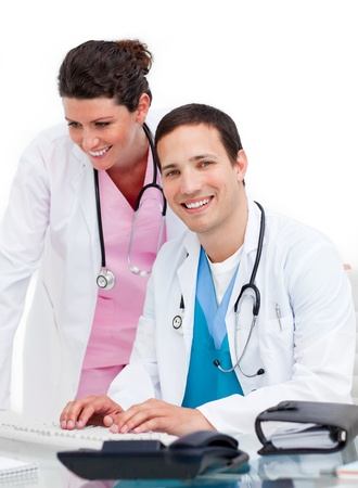Nice doctor and nurse working at computer photo