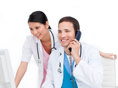 Female nurse and male doctor calling photo