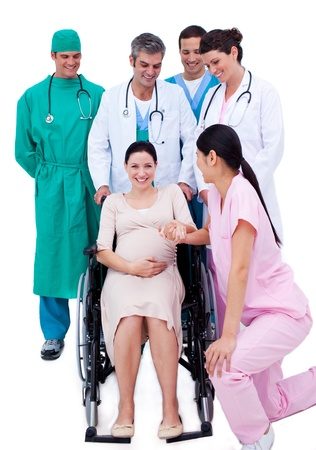Medical team taking care of a pregnant woman photo
