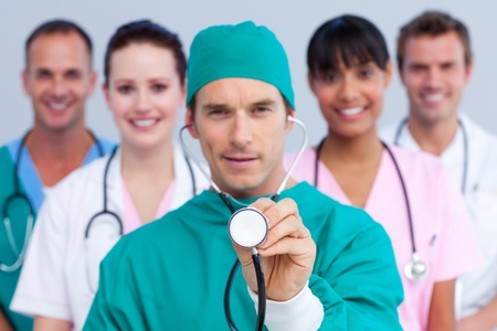 Charismatic surgeon and his medical team Stock Photo - 10258734
