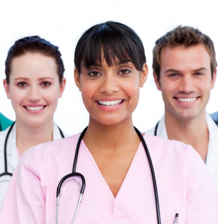 Smiling nurse with her colleagues photo