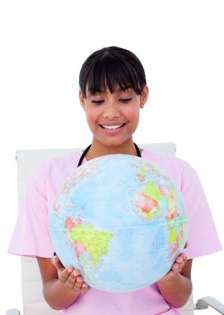 Pretty nurse with a globe photo