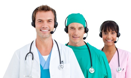 Self-assured three doctors smiling against a white background photo