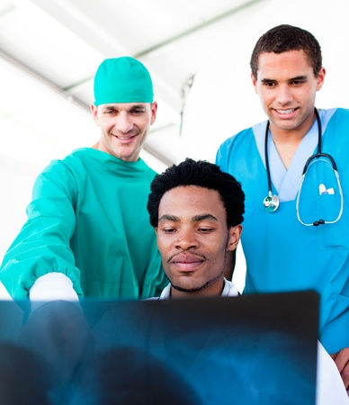 Optimistic male doctors looking at X-Ray photo