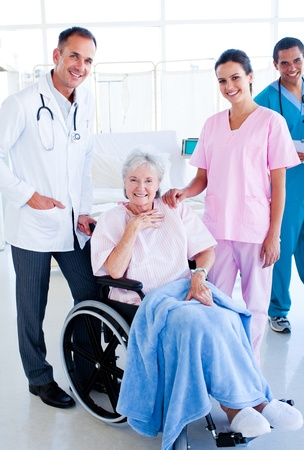 Serious medical team taking care of a senior woman Stock Photo - 10259427