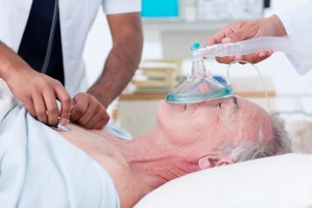 intensive care unit: Doctors resuscitating a senior patient