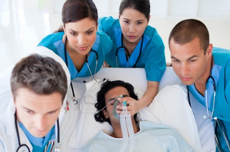 urgent: Emergency team carrying a patient Stock Photo