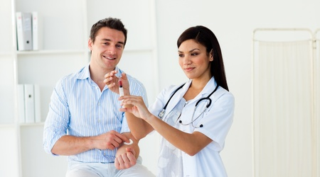 Female doctor preparing an injection Stock Photo - 10255879