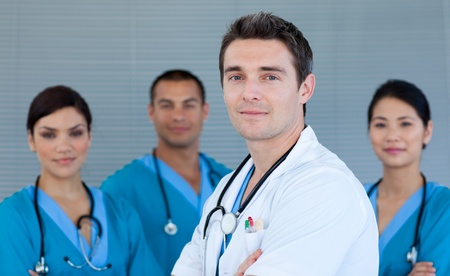 Young male Doctor with his team in the background photo