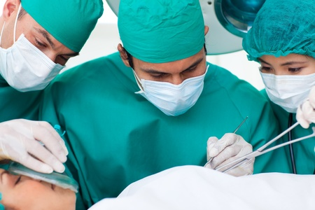 Portrait of surgeons in operative room photo